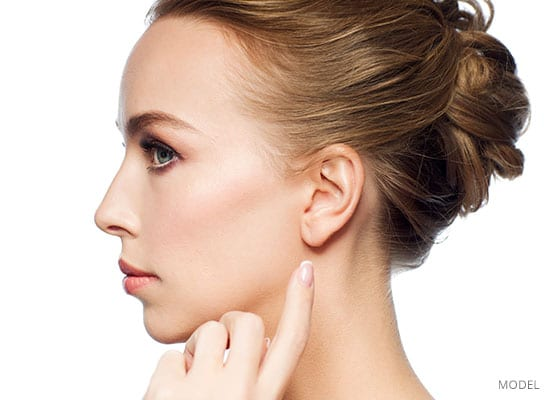 Woman's profile pointing at ear