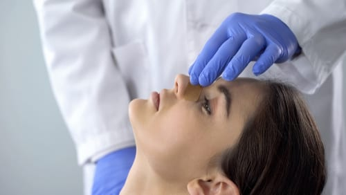 doctor examining patient nose after rhinoplasty surgery, medical aid, healthcare-img-blog