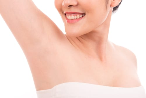 asian women raised her hands up and shows groomed armpits-img-blog