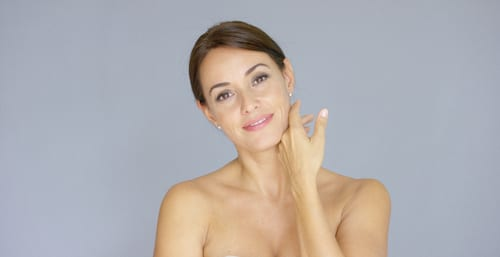 pretty bare shouldered woman with fingers on neck-img-blog