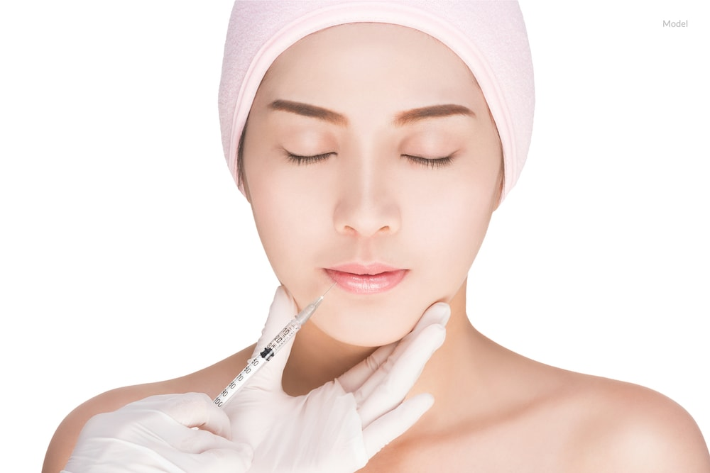 A woman getting a dermal filler injection.